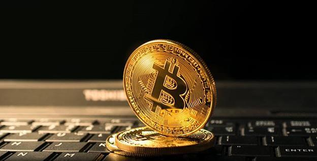 Analiștii se așteaptă ca moneda virtuală bitcoin să scadă înspre 3.000 dolari/unitate, în 2019