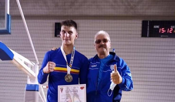 Andrei Drăgan şi antrenorul Mihai Constantin