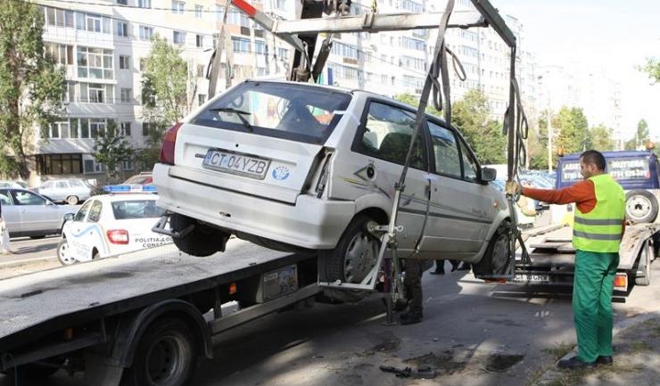 Doar administrația publică locală și administratorul drumului public pot ridica mașinile parcate neregulamentar, din 2017