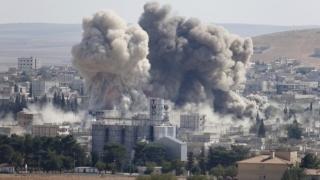 Coaliţia internaţională a efectuat 17 raiduri aeriene în Irak şi Siria