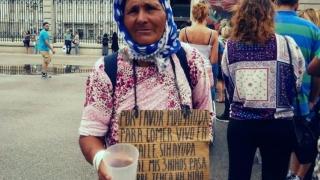 Români obligați să cerșească în Spania
