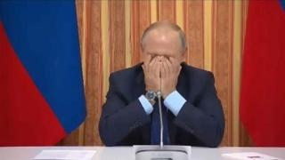 Putin a râs de propriul ministru