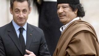 Sarkozy ar fi primit valize cu milioane de euro de la Gaddafi