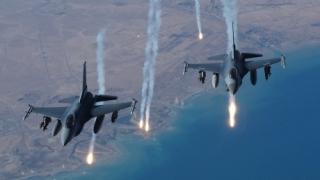 Coaliția internațională a efectuat zeci de raiduri aeriene în Siria și Irak