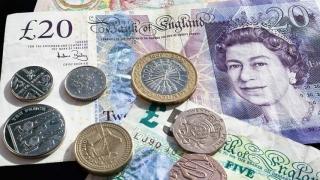 Lira sterlină a scăzut pentru a doua săptămână consecutiv