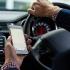 Amendă pentru șoferii care ţin telefonul în mână la volan