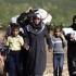 Turcia este pregătită să-și deschidă frontiera sirienilor care fug din Alep