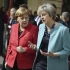 Ca fetele... May şi Merkel se întâlnesc pentru a discuta despre Brexit