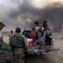 Mii de irakieni părăsesc Mosulul și se refugiază în împrejurimi