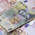 Leul crește în raport cu euro și dolarul american