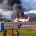 Un avion cu 141 de persoane la bord a luat foc la aterizare